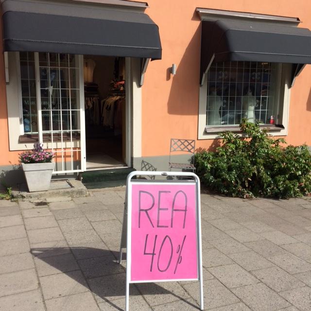 REA skylt och butik